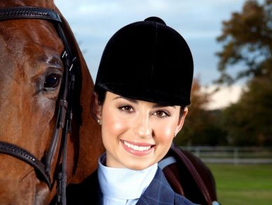 Rae Ambassador Juliette Dell standing by horse